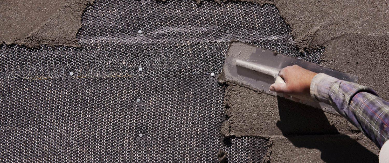 recladding stucco siding stone tile